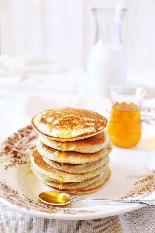 Pancake with honey. And milk stock image