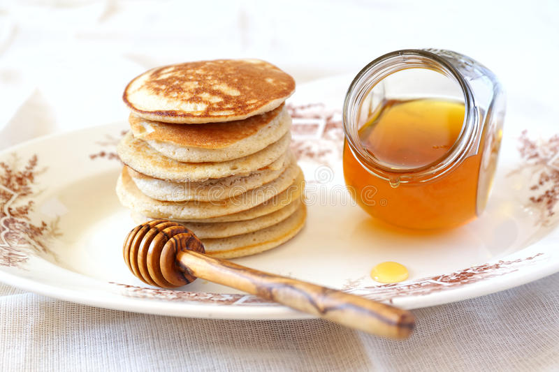 Pancake with honey. On vintage plate stock image