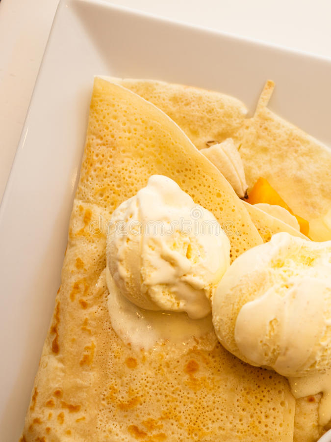 Pancake with ice cream on plate. Pancake with ice cream on white plate top view royalty free stock photos