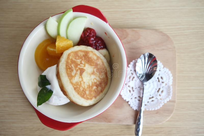 Pancake with icecream. On wooden plate stock photo
