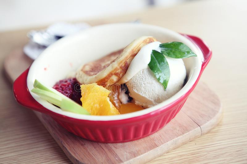 Pancake with icecream. On wooden plate stock photos