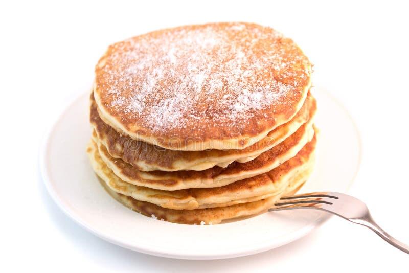 Pancake isolati su fondo bianco immagini stock libere da diritti