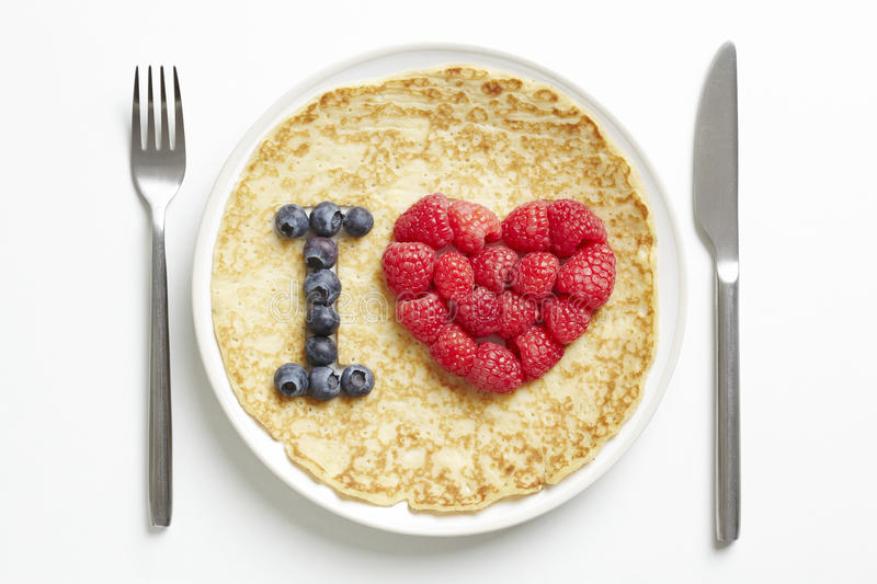 Pancake with love heart shape stock images