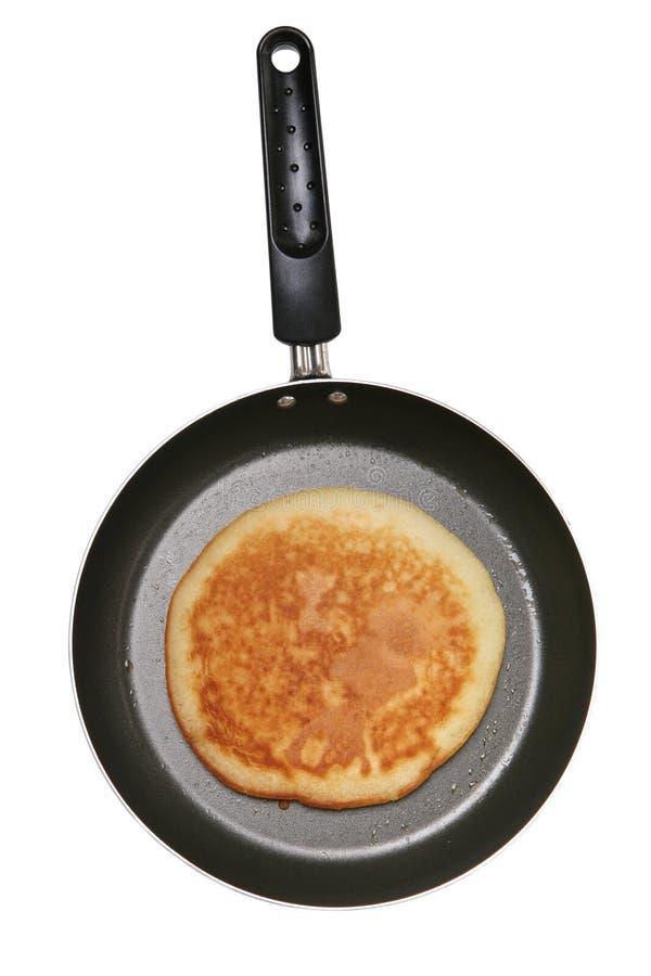Pancake in pan. A delicious looking pancake cooking in a pan stock photo