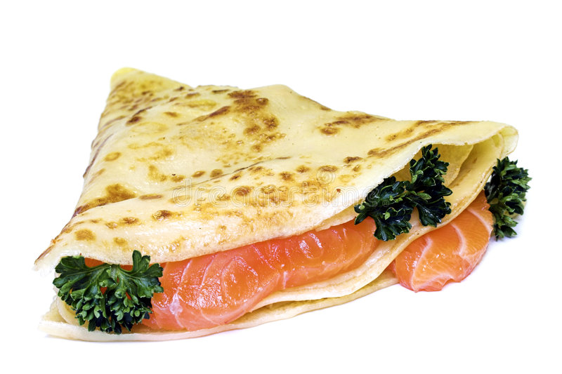 Pancake with red fish royalty free stock image