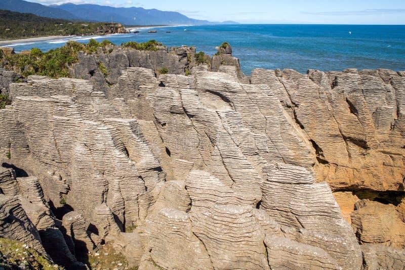 Pancake Rocks vid Punakaiki på västra kusten, Sydön, Nya Zeeland arkivfoton
