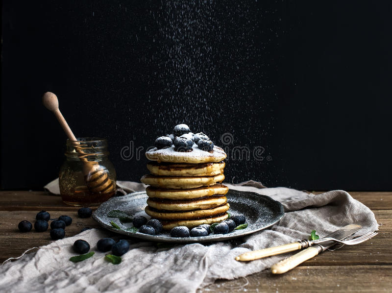 Pancake tower with fresh blueberry and mint on a. Rustic metal plate stock photo