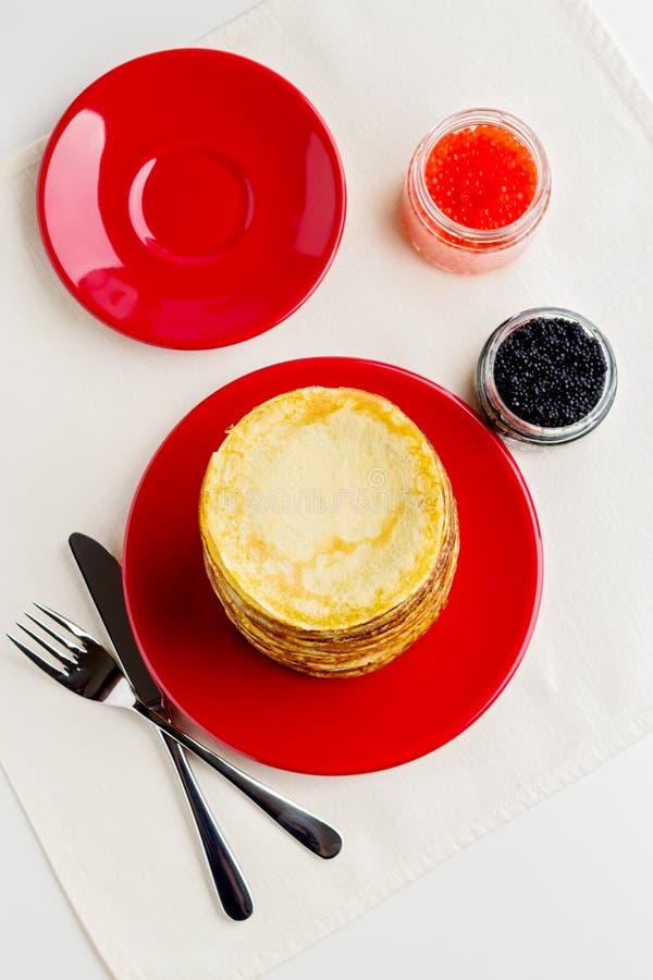 Pancake week. Pancakes with red and black caviar. Selective focus royalty free stock photos