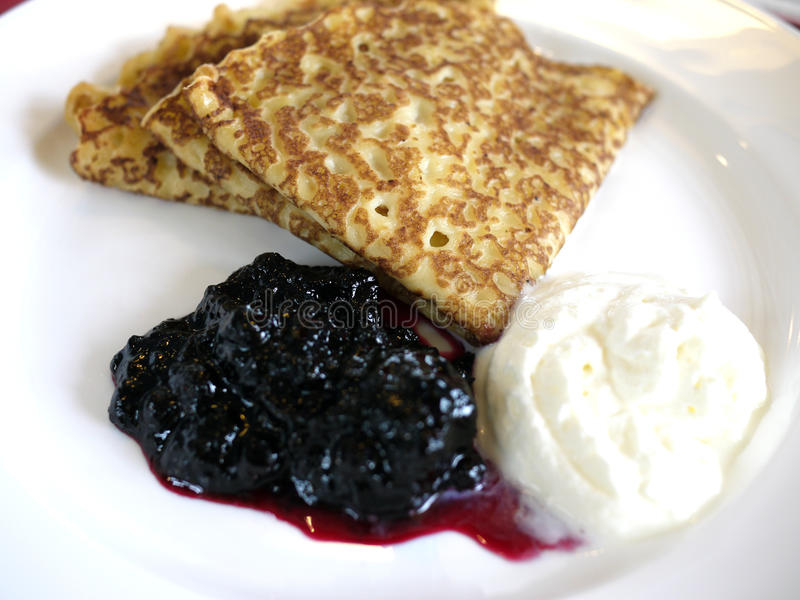 Pancakes. With Blueberry Jam and Sour Cream royalty free stock image