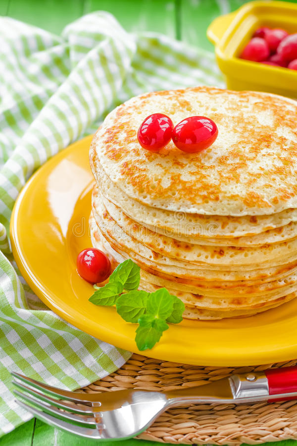 Pancakes. Shrove Tuesday pancakes with berries and mint royalty free stock photo