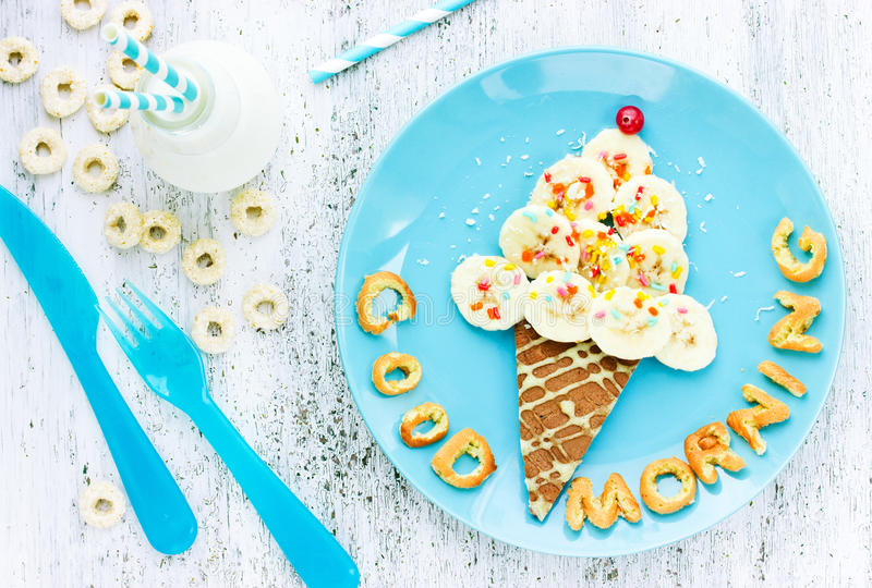 Pancakes with banana in the form of ice cream for children fun b. Reakfast. Good morning concept royalty free stock photography