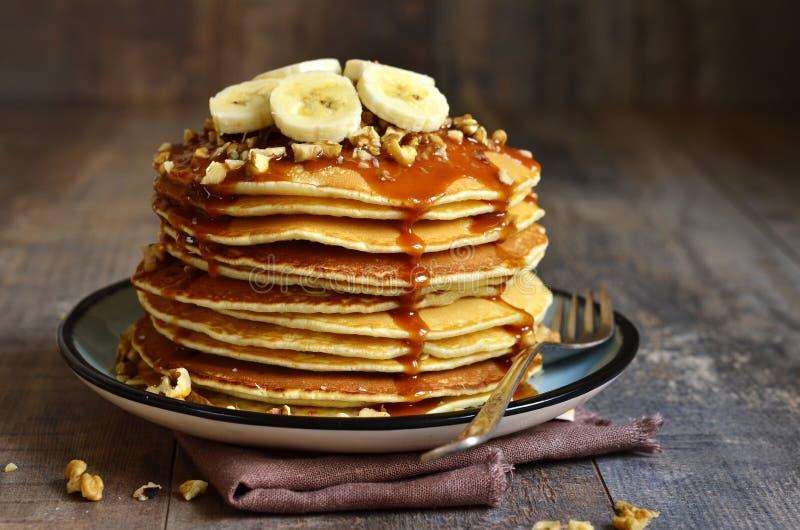 Pancakes with banana,walnut and caramel. Pancakes with banana,walnut and caramel for a breakfast stock images