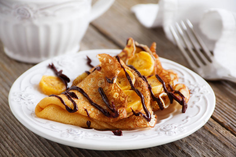 Pancakes. With bananas and chocolate stock photo