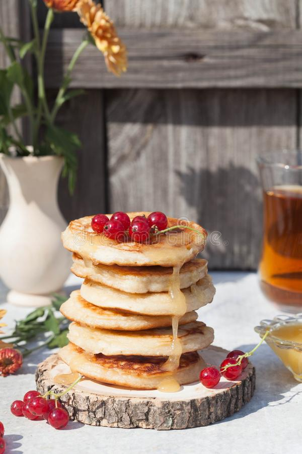 Pancakes with berries and honey stock photos