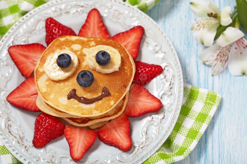 Pancakes with berries for kids royalty free stock photo