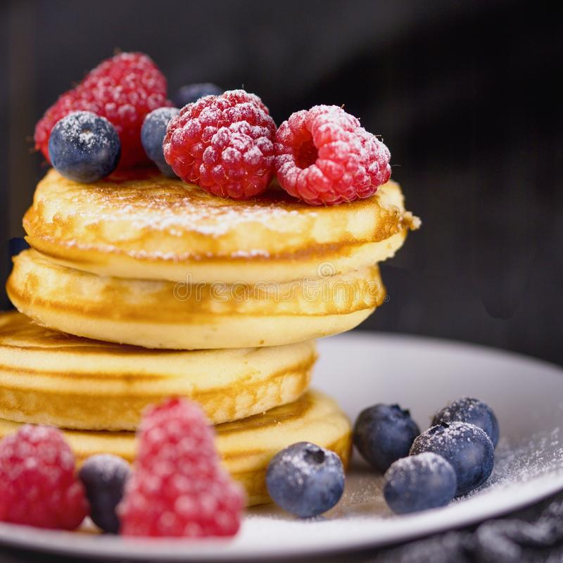 Pancakes with berries and sugar stock photo
