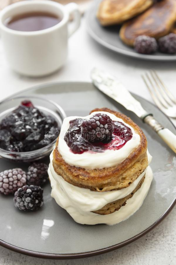 Pancakes with berry and jam. homemade, vegan pancakes with cream and fruit jam royalty free stock image