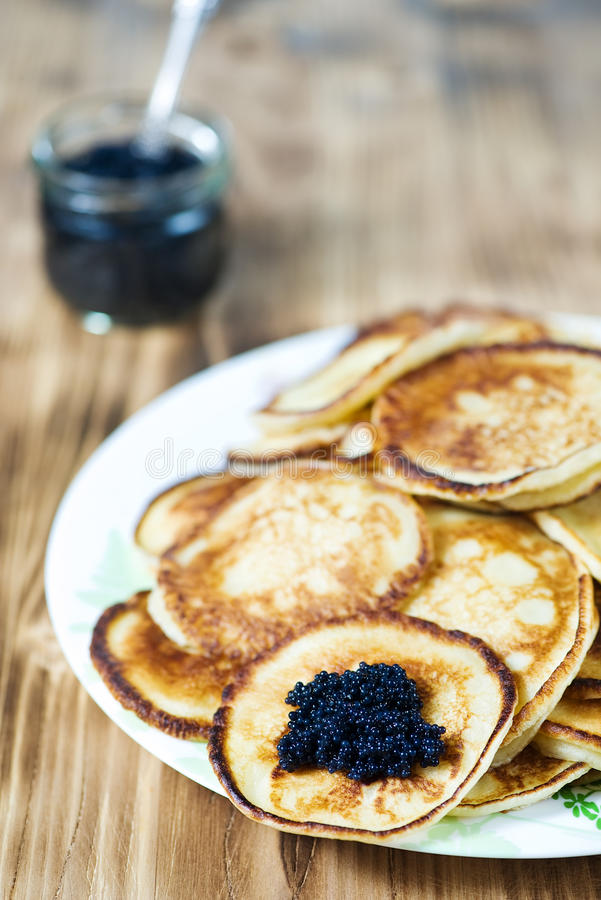 Pancakes with black caviar royalty free stock photo