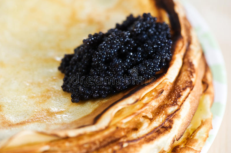 Pancakes with black caviar royalty free stock images