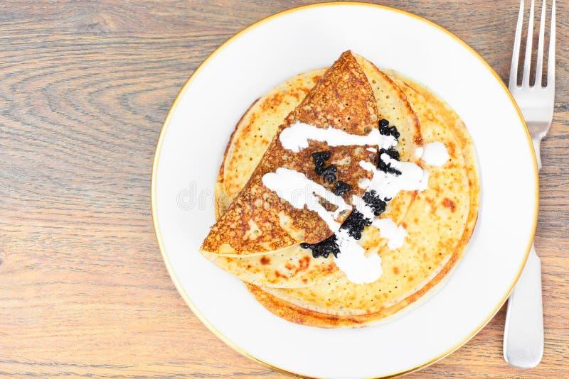 Pancakes with Black Caviar. On Plate Studio Photo stock images