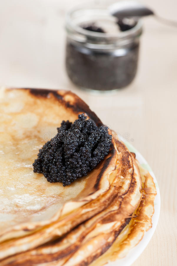 Pancakes with black caviar stock photo