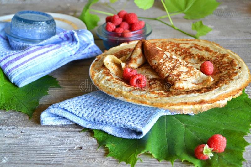 Pancakes with caramel sauce and raspberries. Gourmet food. Breakfast food table royalty free stock photo