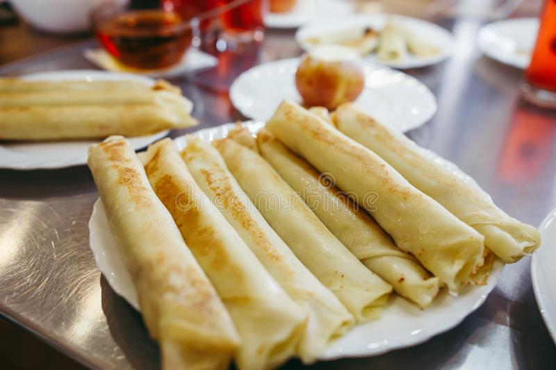 Pancakes with cheese are served with honey royalty free stock photos