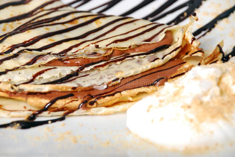Pancakes with chocolate royalty free stock images