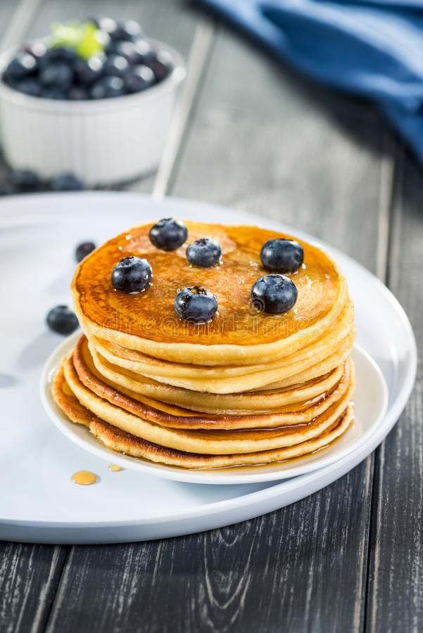 Pancakes close up, with fresh blueberries and maple syrup. royalty free stock photo