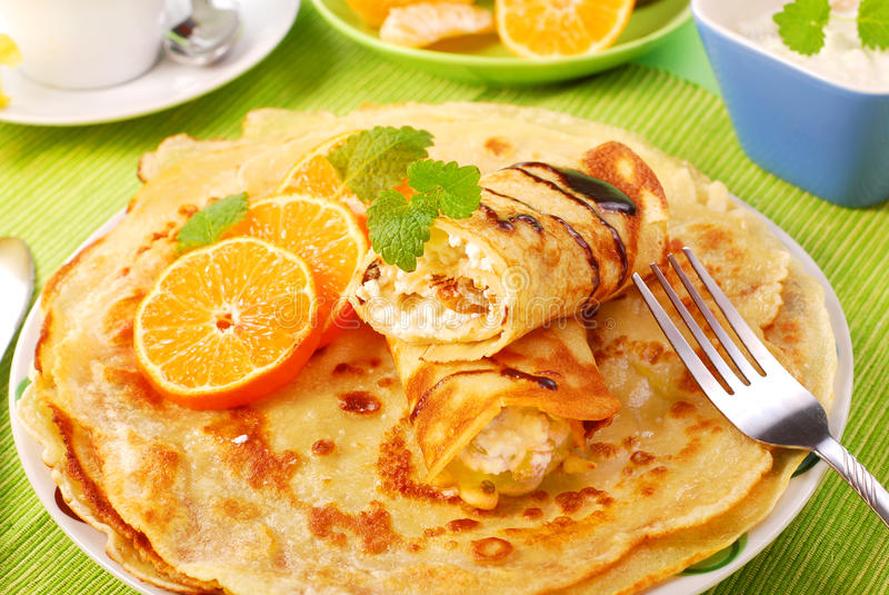 Pancakes with with cottage cheese and orange stock images