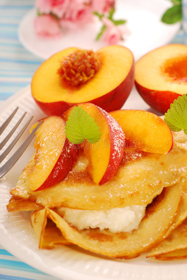 Pancakes with cottage cheese and peach royalty free stock images