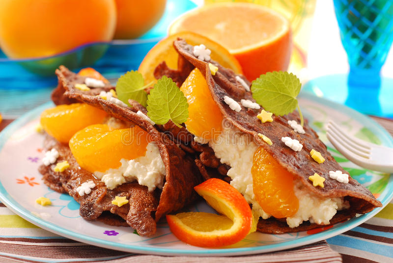 pancakes with cottage cheese and tangerines royalty free stock photos