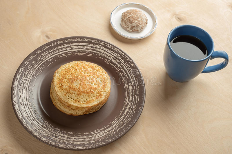 Pancakes and cup stock photography