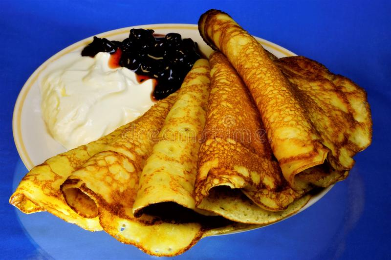 Pancakes-flat and round flour products, prepared from batter by frying in a pan. Pancakes are used as an independent dish and stock images