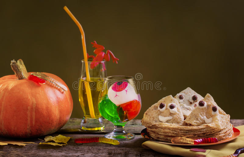Pancakes in the form of ghost on dark background stock images