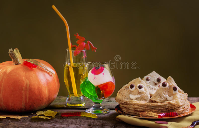 Pancakes in the form of a ghost on dark background royalty free stock images