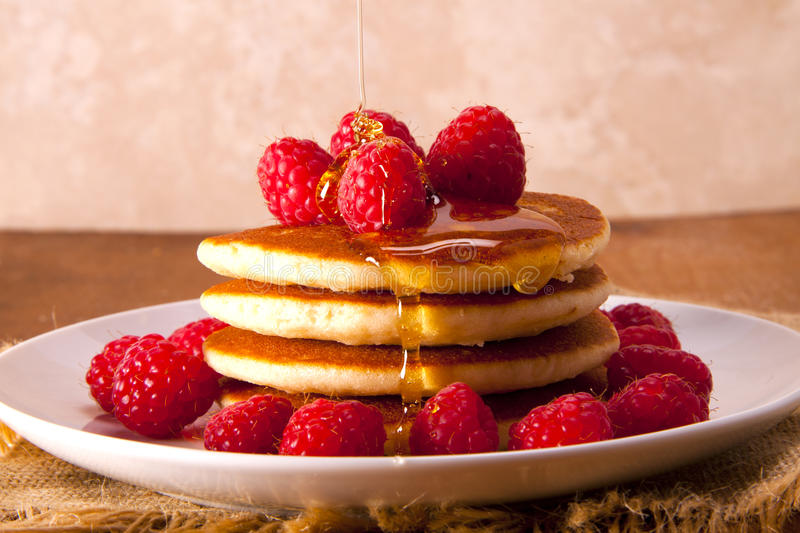 Pancakes with fresh and delicious raspberries. stock photos