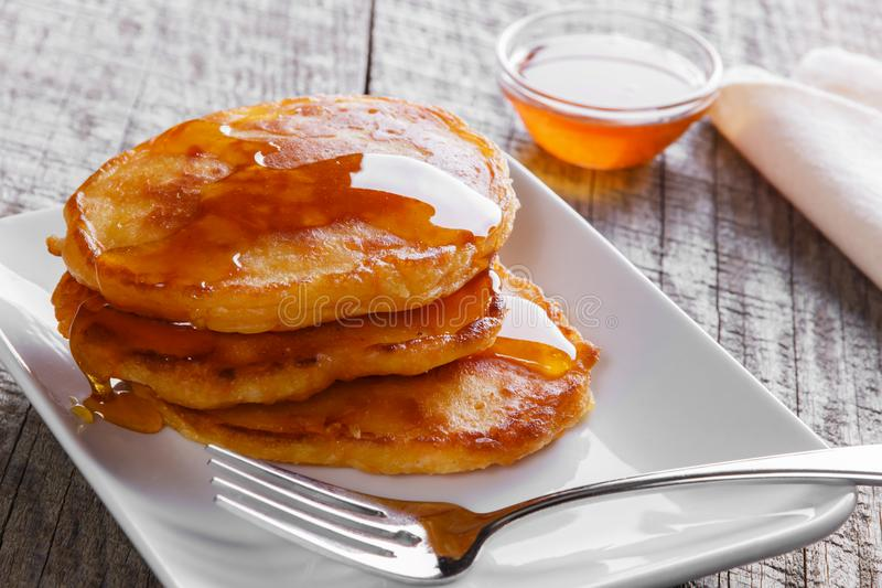 Pancakes fritters carrot with maple syrup breakfast. Pancakes fritters carrot with maple syrup stock image