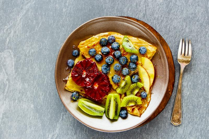 Pancakes and fruits stock images