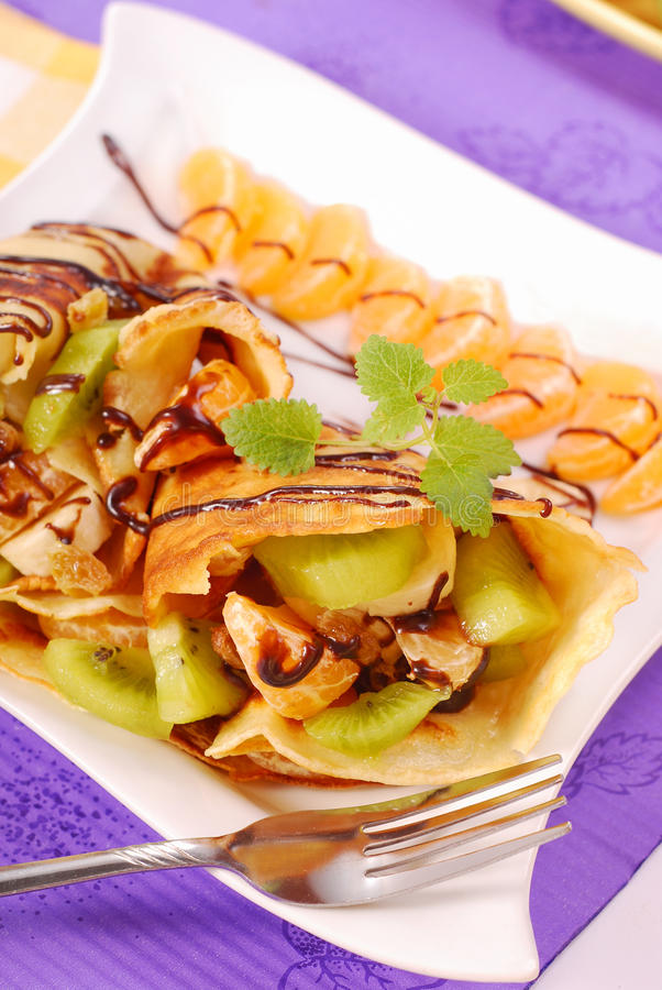 Pancakes With Fruits Poured With Chocolate Royalty Free Stock Image