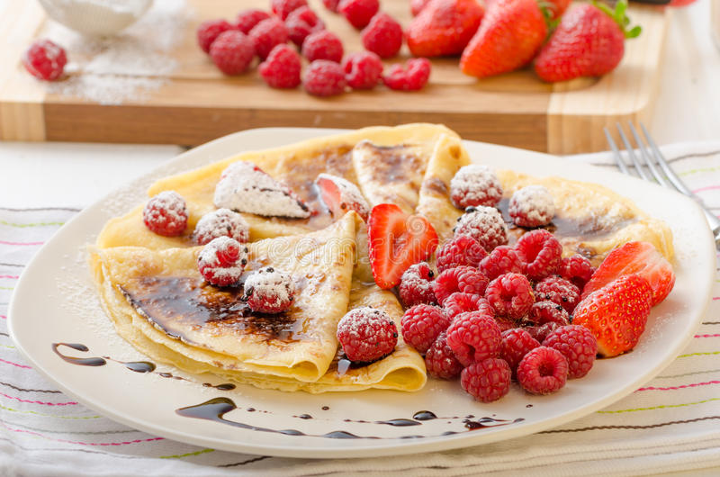 Pancakes with homemade balsamic reduction and fresh fruit royalty free stock photography