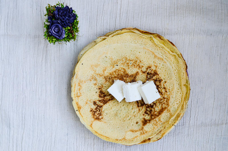 Pancakes. Homemade pancakes and cheese on whte background stock photography