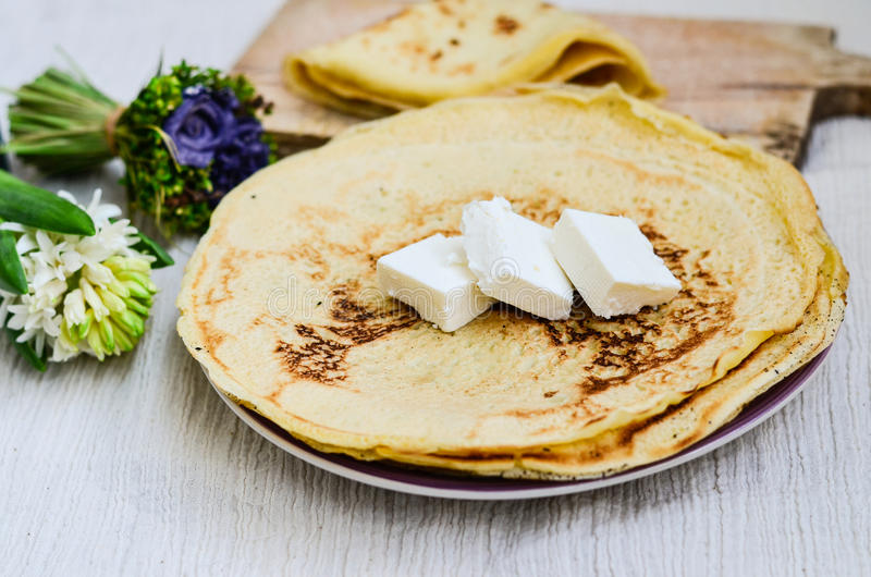 Pancakes. Homemade pancakes and cheese on whte background royalty free stock image