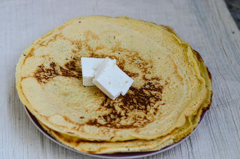 Pancakes. Homemade pancakes and cheese on whte background royalty free stock photography
