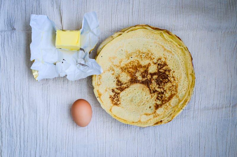 Pancakes. Homemade pancakes ,egg and butter stock photos