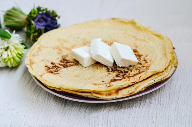 Pancakes. Homemade pancakes with white cheese royalty free stock image
