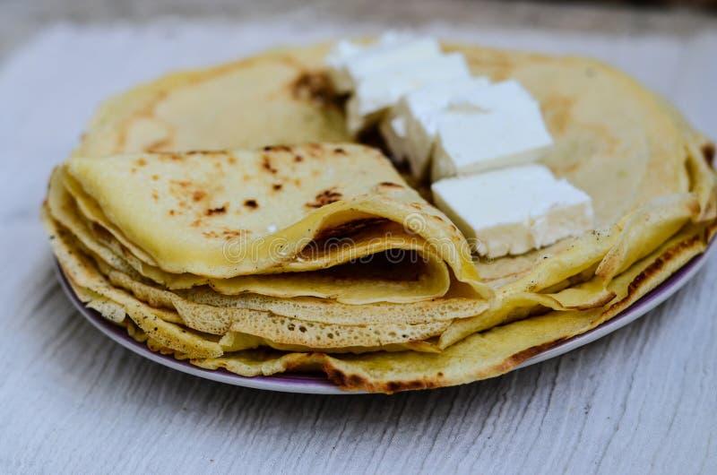Pancakes. Homemade pancakes with white cheese royalty free stock photos