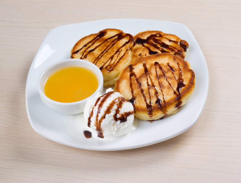 Pancakes with icecream and honey. Morning meal.pancakes with icecream and honey royalty free stock image
