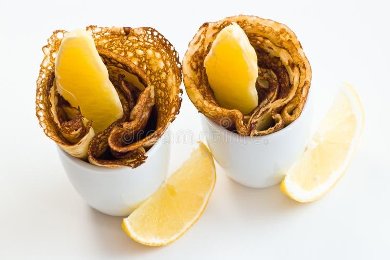 Pancakes with lemon stock image
