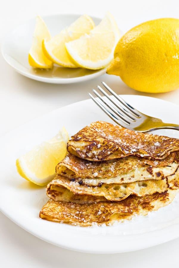Pancakes with lemon royalty free stock photo